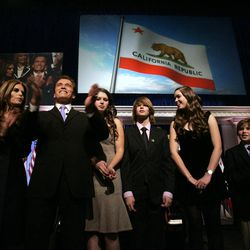 """FILE -- In this Jan. 5, 2007 file photo, Gov. Arnold Schwarzenegger is seen with his family, wife Maria Shriver, left, daughter Katherine, third from left, son Patrick, fourth from left, daughter Christina, fifth from left, son Christopher, second from right, and mother-in-law Eunice Shriver, right, following his second inauguration in Sacramento, Calif.  In an interview with """"60 minutes"""" that is scheduled to air Sunday, Schwarzenegger says the affair he had with longtime housekeeper Mildred Baena, that led to a son, was """"the stupidest thing"""", he ever did to Shriver, who filed for divorce last July."""