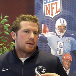 Penn State quarterback Matt McGloin speaks with reporters in front of a picture of former Nittany Lions quarterback Kerry Collins at the Lasch Football Building in State College, Pa., on Wednesday, Feb. 1, 2012.