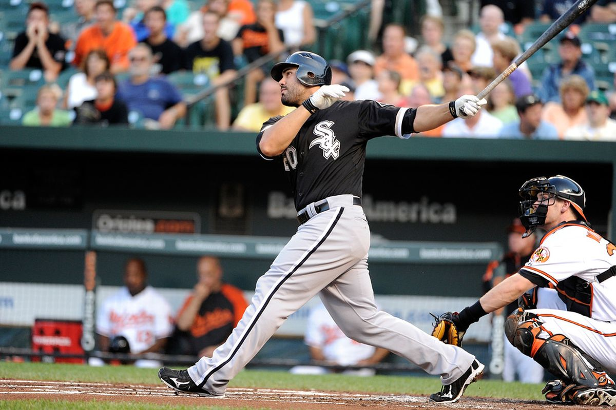 BALTIMORE, MD - AUGUST 09:  Carlos Quentin #20 of the Chicago White Sox hits a home run in the second inning against the Baltimore Orioles at Oriole Park at Camden Yards on August 9, 2011 in Baltimore, Maryland.  (Photo by Greg Fiume/Getty Images)