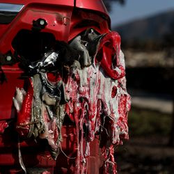 The melted plastic of a car's taillight is seen on Saturday, Sept. 19, 2020, after the Almeda Fire swept through Talent, Ore.