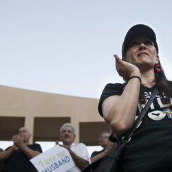 Ginger Phillips claps during a same sex marriage celebration at Library Square in Salt Lake City, Monday, Oct. 6, 2014.
