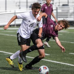 Emery Spartan Marko Ilijic (16) and Morgan Trojan Kade Buchanan (21) fight for the ball during a 3A semifinal game of soccer between the Emery Spartans and Morgan Trojansat Juan Diego Catholic High School in Draper on Monday, May 17, 2021.