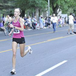 Lindsey Dunkley runs the Deseret News 10K race that started in Research Park and ended in Liberty Park in Salt Lake City Saturday.