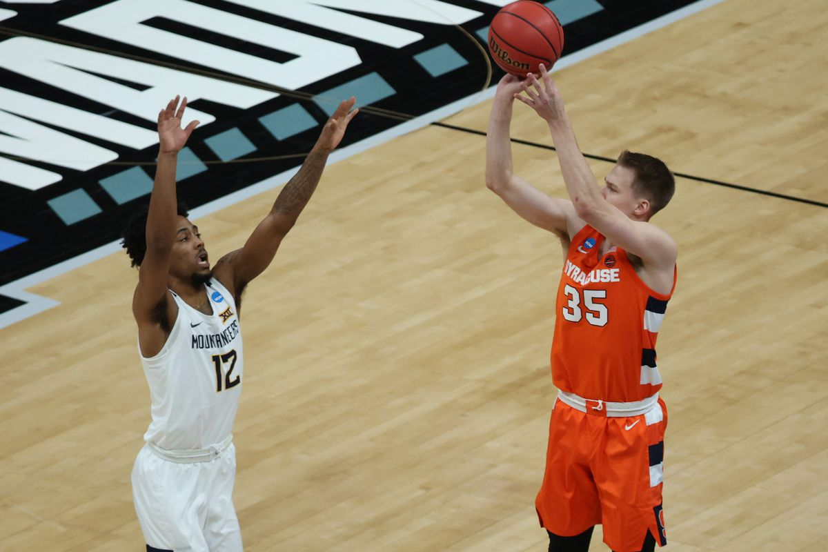 Syracuse Orange guard Buddy Boeheim shoots the ball over West Virginia Mountaineers guard Taz Sherman in the first half in the second round of the 2021 NCAA Tournament at Bankers Life Fieldhouse.