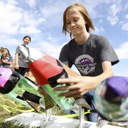 Andrew Foote, aPrefreshman Engineering Program student, prepares to launch homemade rockets outside of Joel P. Jensen Middle School in West Jordan on Thursday, July 22, 2021. The summer enrichment program aims to introduce students to careers in STEM-related fields.