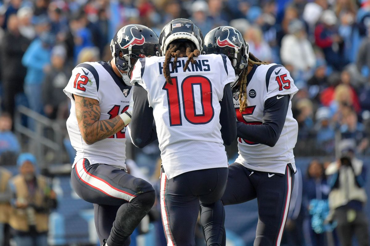 Houston Texans wide receiver Kenny Stills huddles with teammates Houston wide receiver DeAndre Hopkins and Houston wide receiver Will Fuller after catching a touchdown pass against the Tennessee Titans during the first half at Nissan Stadium.
