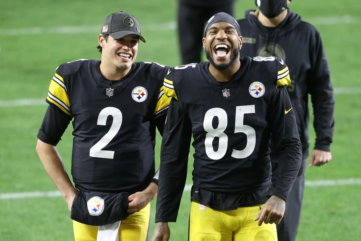 Pittsburgh Steelers quarterback Mason Rudolph and tight end Eric Ebron react leaving the field after defeating the Cincinnati Bengals at Heinz Field. The Steelers won 36-10.