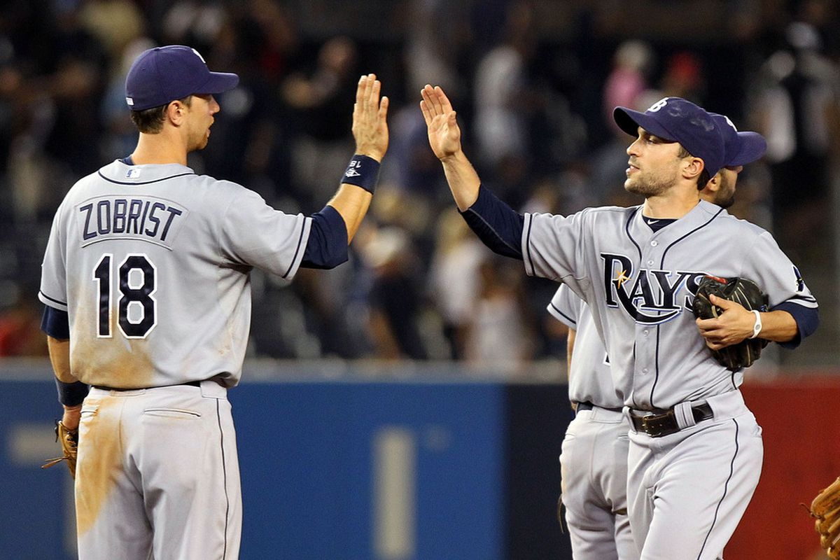 NEW YORK, NY - JULY 07:  Ben Zobrist #18 and Sam Fuld #5 of the Tampa Bay Rays celebrate after defeating the New York Yankees at Yankee Stadium on July 7, 2011 in the Bronx borough of New York City.  (Photo by Nick Laham/Getty Images)