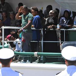 Migrants wait to disembark from the Spanish ship 'Rio Segura' in the harbor of Salerno, Italy, Thursday,  June 29, 2017. Over 1200 migrants, including children, were rescued while attempting to cross the Mediterranean. The European Union's foreign minister says the bloc supports Italy's stance that it can no longer handle the flood of migrants alone, and she insists other EU countries share the burden.