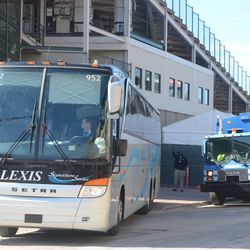 3:46 p.m. Visiting team bus backs in next to Gate D -