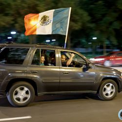 July 7, 2019 - Chicago, Illinois, United States - Mexico fans drive down Michigan Avenue honking their horns in celebration of defeating USA 1-0 to win the Gold Cup Final at Soldier Field.