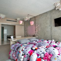 In addition to the whimsical clouds, Knibb also created that bedspread made from stuffed Hello Kitty toys.