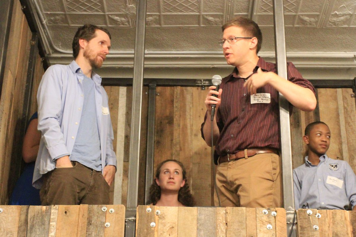 Harvest Collegiate High School teachers Andy Snyder (left) and Stephen Lazar (right) share stories about their students.