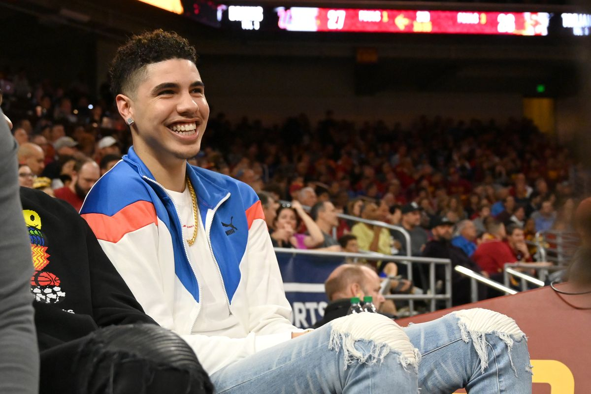 Professional basketball player LaMelo Ball, right, attends the game between the USC Trojans and the UCLA Bruins at Galen Center on March 7, 2020 in Los Angeles, California.