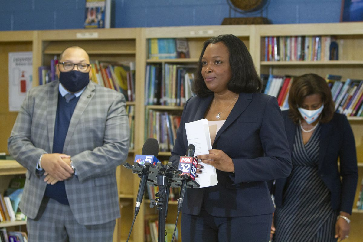 School chief Janice Jackson standing by a microphone.