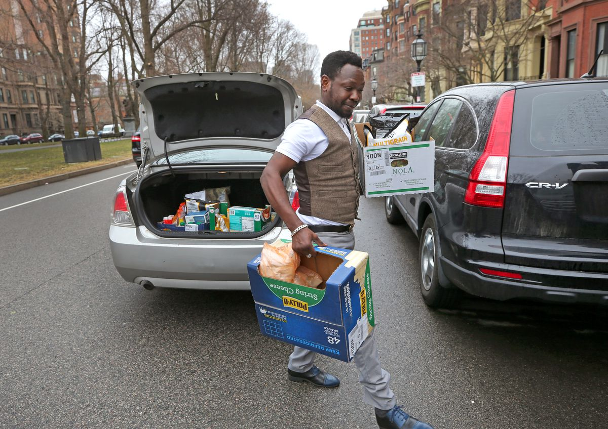 A man makes a delivery for the grocery service InstaCart.