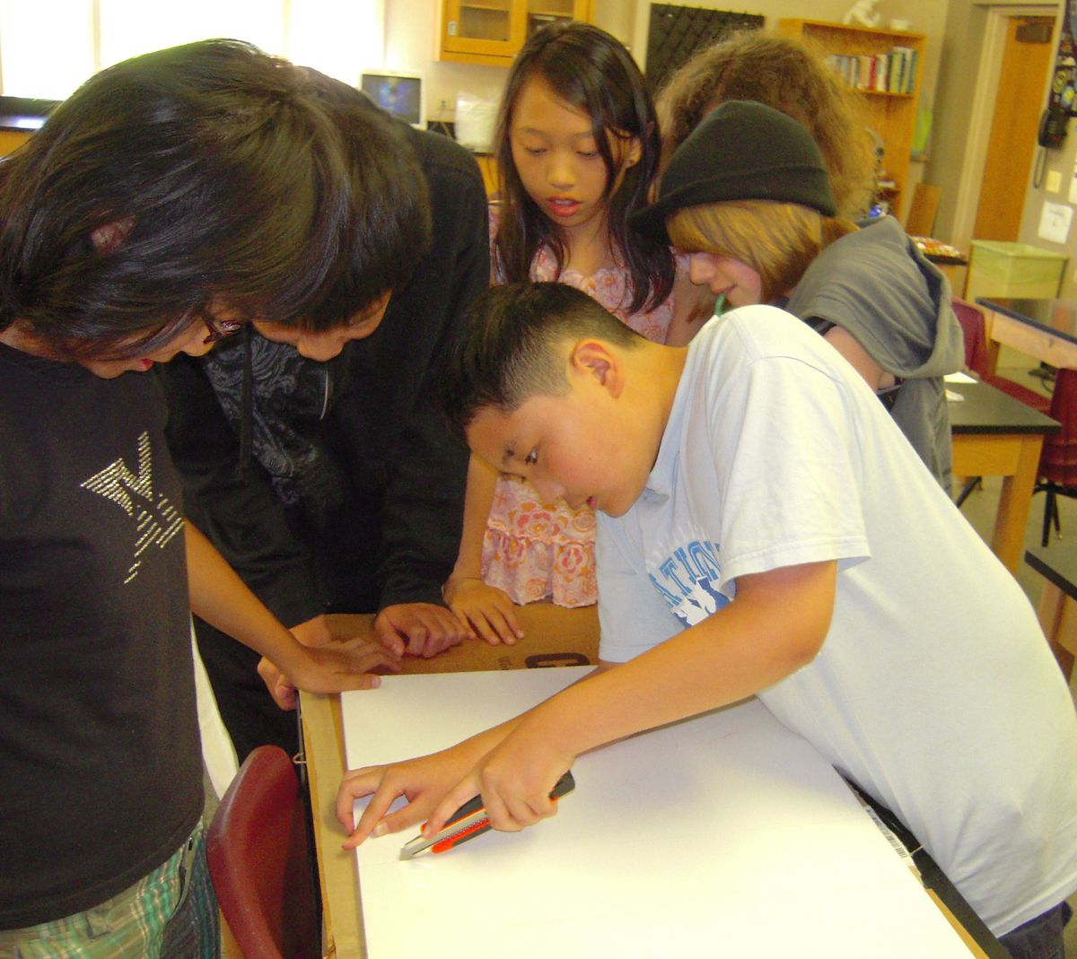 Students work to create a model of a hand for use in a hand-washing display.
