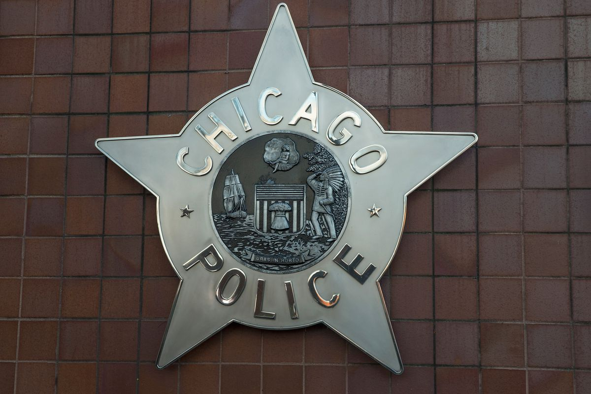 CHICAGO, IL - DECEMBER 01: A Chicago police badge hangs in front of the City of Chicago Public Safety Headquarters on December 1, 2015 in Chicago, Illinois. Following public outcry over the way police handled the shooting death of Laquan McDonald by Chicago police officer Jason Van Dyke, Mayor Rahm Emanuel today announced he had fired Chicago Police Superintendant Garry McCarthy. McCarthy, Emanuel and Cook County States Attorney Anita Alvarez have been accused of trying to cover up the shooting. (Photo by Scott Olson/Getty Images) ORG XMIT: 594422627
