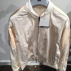 Cream Taffeta varsity jacket, $623 (was $2,490)