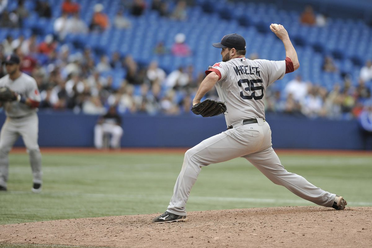 Dan Wheeler of the Boston Red Sox delivers a pitch during MLB game action against the Toronto Blue Jays at Rogers Centre in Toronto, Ontario, Canada. (Photo by Brad White/Getty Images)