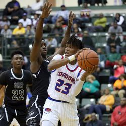 Curie's Ramean Hinton (23) is trapped by Orr's Greg Outlaw (0) in their CPS semi final game at Chicago State University, Friday, February 15, 2019. | Kevin Tanaka/For the Sun Times