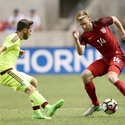 Venezuela's Francisco La Mantia (13) and United States' Tim Ream (14) fight for the ball during a soccer game at Rio Tinto Stadium in Sandy on Saturday, June 3, 2017. They tied 1-1.