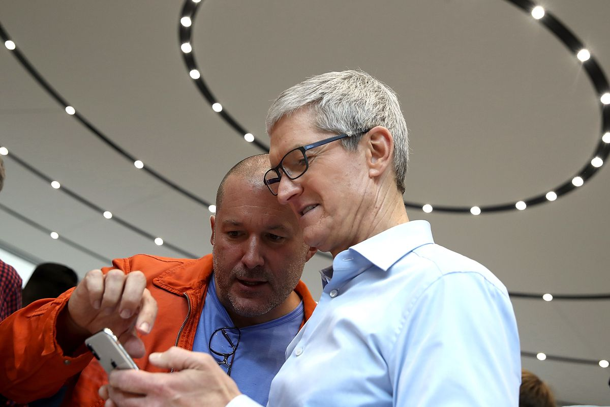 Apple CEO Tim Cook (R) and Apple chief design officer Jonathan Ive (L) look at the new Apple iPhones during an Apple special event at the Steve Jobs Theater on the Apple Park campus on September 12, 2017, in Cupertino, Calif.