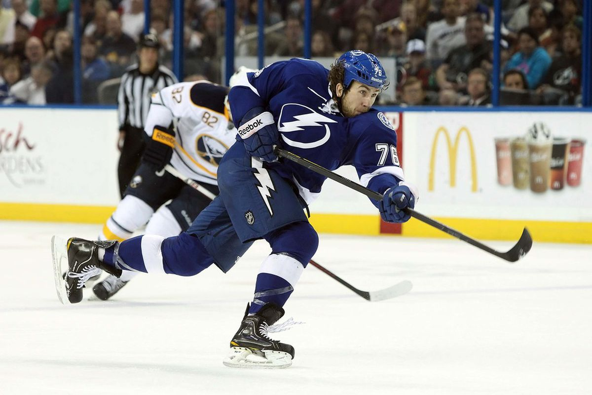 March 19, 2012; Tampa FL, USA; Tampa Bay Lightning left wing Pierre-Cedrick Labrie (76) shoots against the Buffalo Sabres during the second period at Tampa Bay Times Forum. Mandatory Credit: Kim Klement-US PRESSWIRE