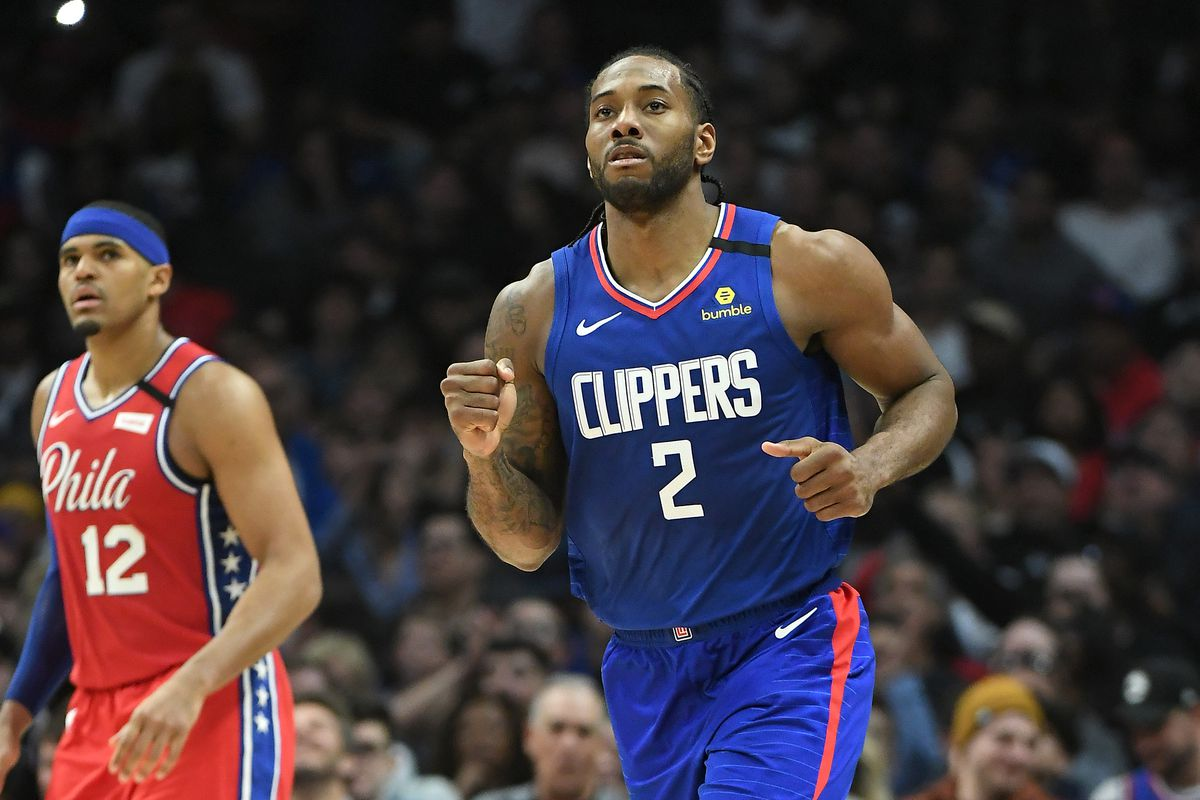 Los Angeles Clippers forward Kawhi Leonard pumps his fist as he heads down court after a three point basket in the second half of the game against the Philadelphia 76ers at Staples Center.