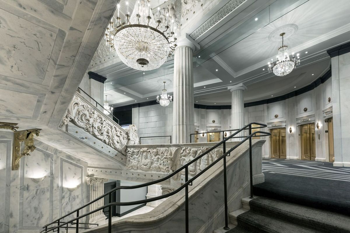 An elaborate lobby done in white marble.