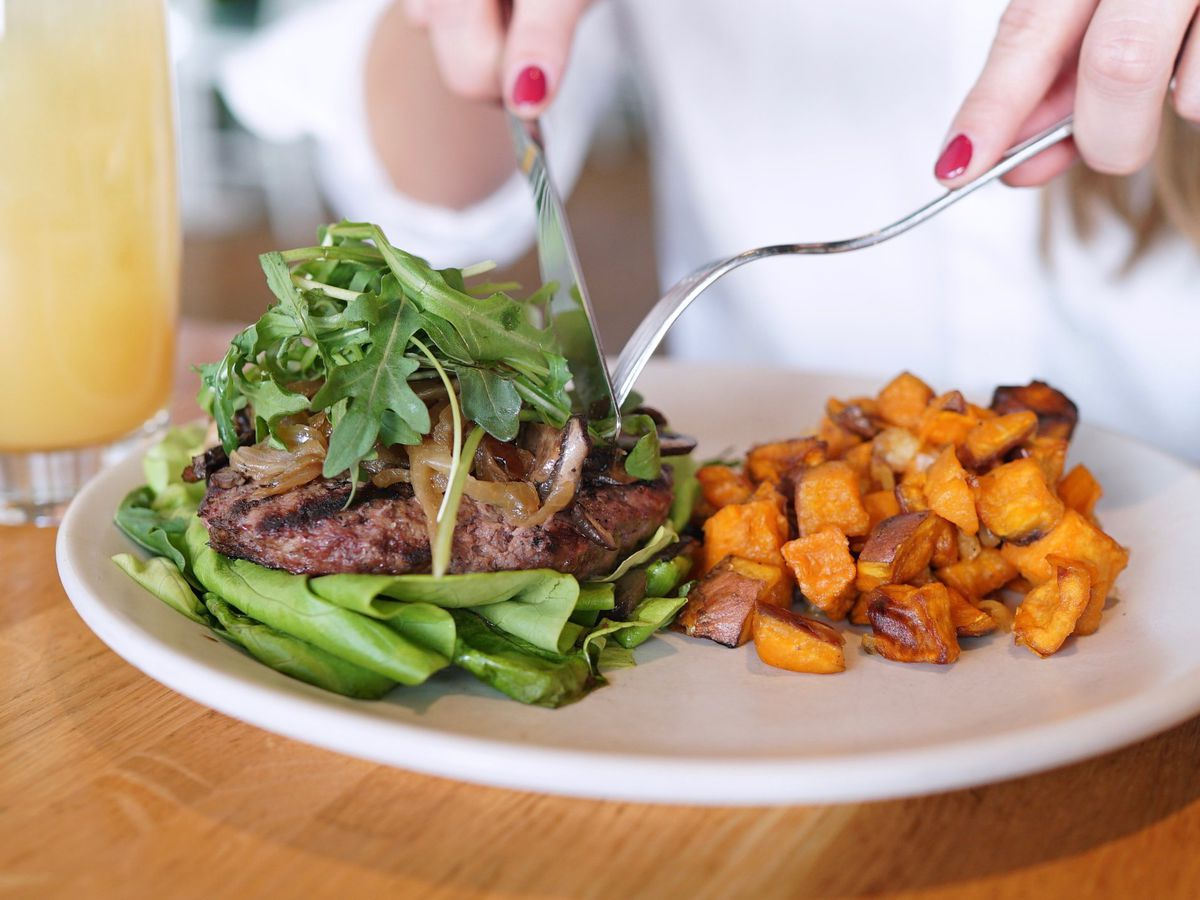 True Food Kitchen's burger on lettuce and sweet potatoes