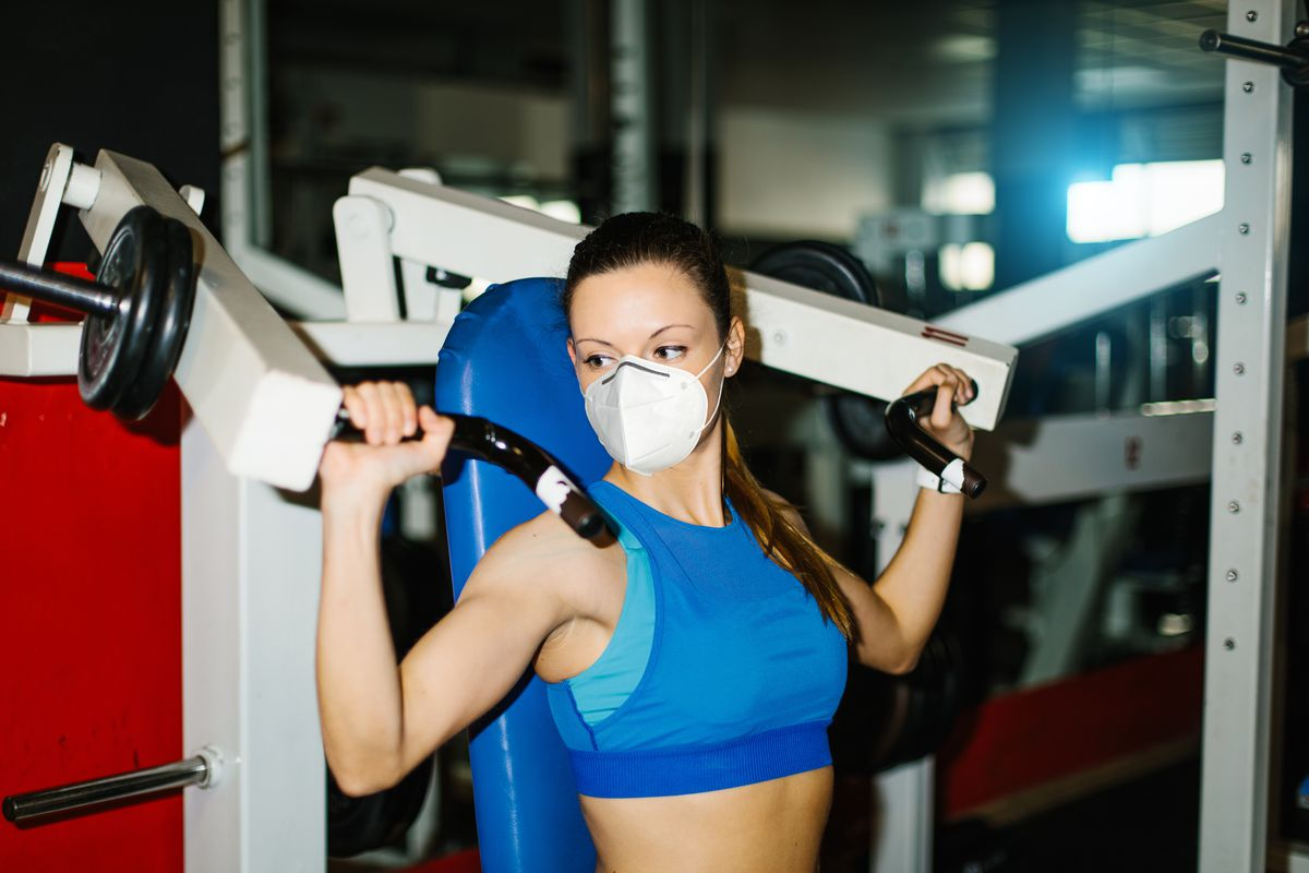 The same thing that makes going to a fitness center safer from COVID-19, also makes the exercise experience decidedly worse. Face masks are among a slew of precautions— including temperature checks, smaller class sizes, sanitization stationsand socially-distanced machines — aimed at minimizing potential exposure of the novel coronavirus that's infectednearly 2 million Americans.