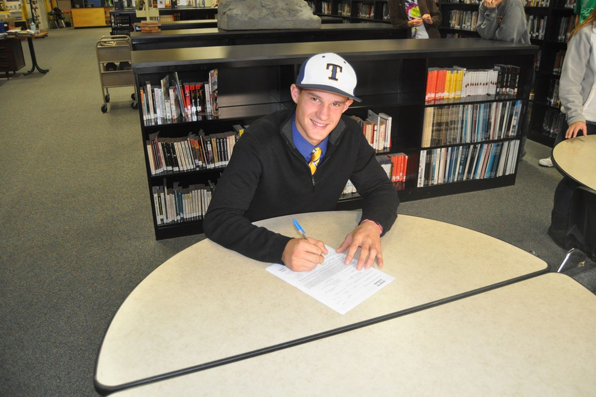 Nate Langhals signs his letter of intent for the Toledo Rockets.