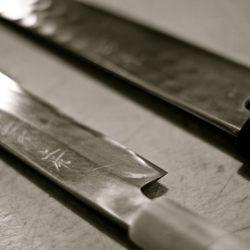 A Yoshikane knife on the right
