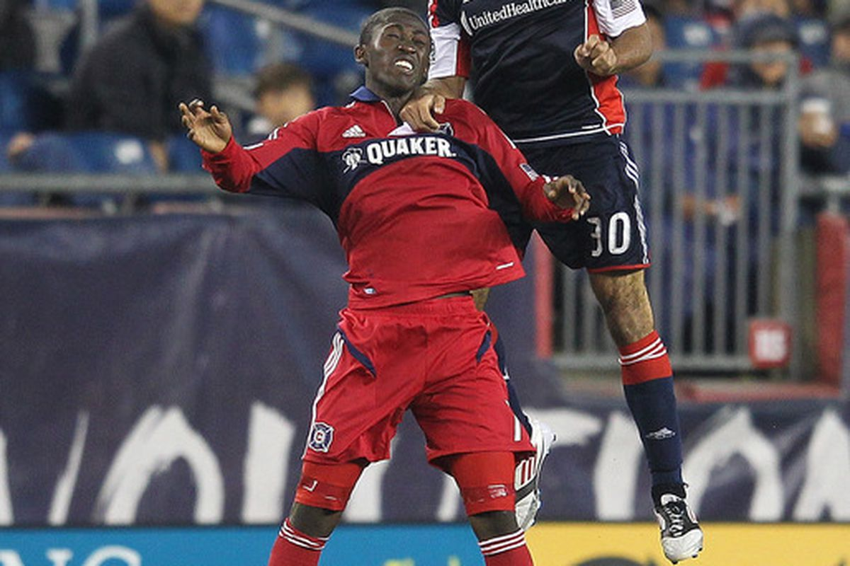 FOXBORO, MA - JUNE 2:  Kevin Alston #30 of the New England Revolution battles Patrick Nyarko #14 of the Chicago Fire for control at Gillette Stadium on June 2, 2012 in Foxboro, Massachusetts. (Photo by Jim Rogash/Getty Images)