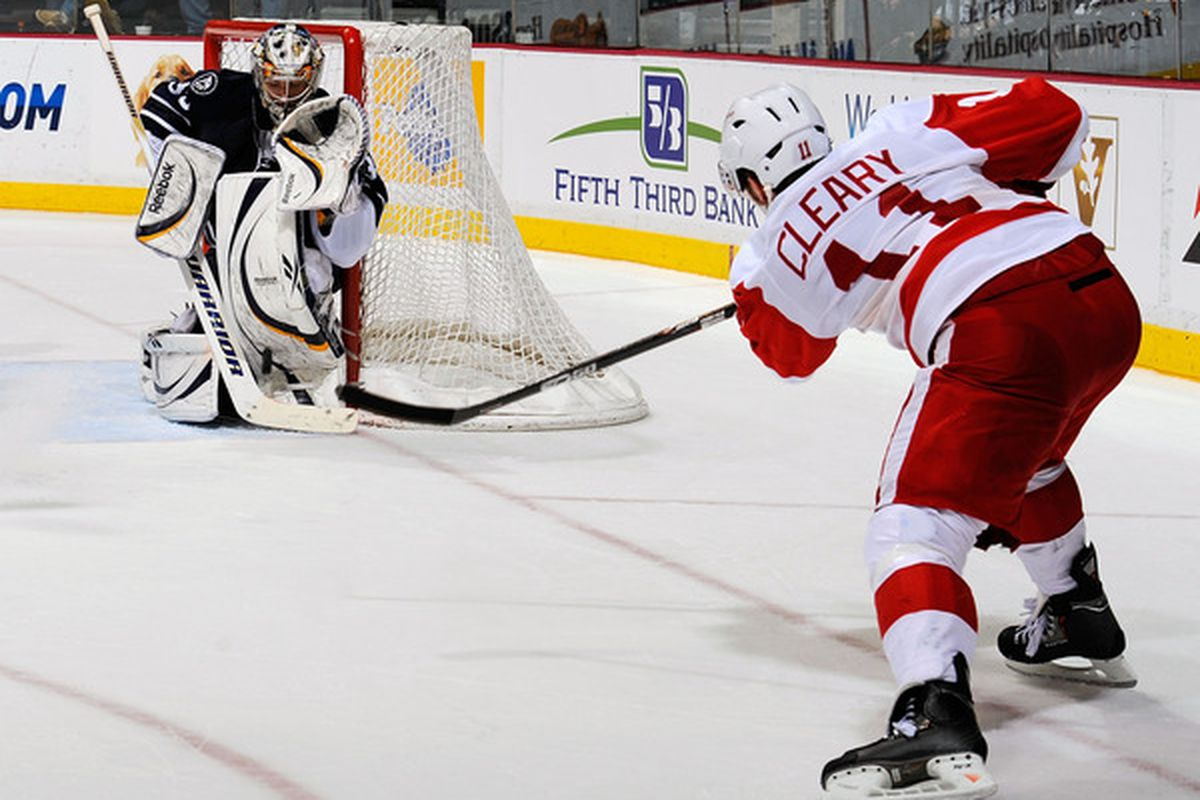 During this game of hide-and-seek, Pekka Rinne tries his best to hide behind the goalpost, but Dan Cleary found him.