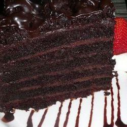 I know this will not go over well with the pastry aficionados in NYC but my fav desert is the 6-7 layer (depends on the night) always moist, almost wet GIGANTIC chocolate layer cake from THE PALM  steakhouse ($18), of course w/ a glass of milk or white Ru