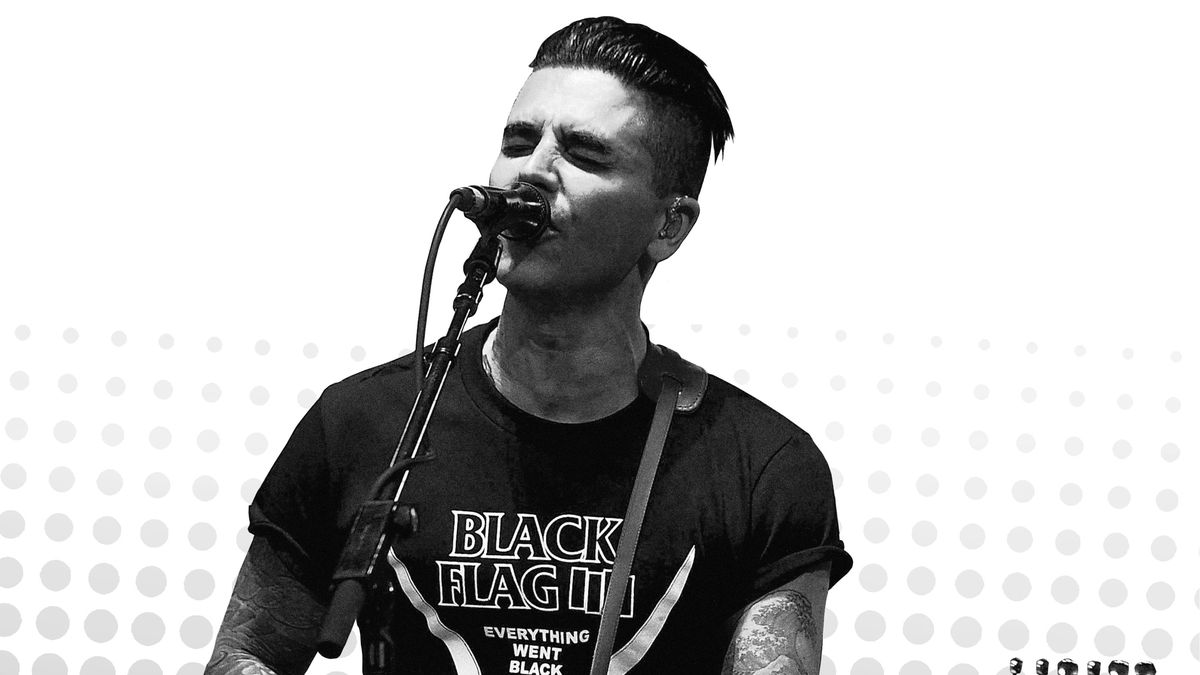 A black-and-white picture of Chris Carrabba playing guitar and singing