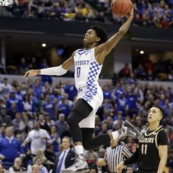 FILE - In this March 19, 2017, file photo, Kentucky guard De'Aaron Fox (0) goes up for a dunk in front of Wichita State guard Landry Shamet (11) during the second half of a second-round game in the men's NCAA college basketball tournament,  in Indianapolis. Fox is expected to be a picked at the NBA Draft.