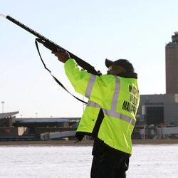 FILE- In this Jan. 16, 2009 file photo, Ulysses Dublin, one of four full-time Massport wildlife technicians, fires a non-lethal pyrotechnic round from a standard shotgun to disperse birds from the runways and surrounding areas at Logan International Airport in Boston, Mass. Although there is evidence that bird-control efforts near airports are paying off, U.S. Sen. Kirsten Gillibrand, D-NY, introduced legislation on Wednesday, April 25, 2012 that would make it easier to round up geese near JFK Airport and kill them, after a second airliner was forced from the skies over New York due to a bird strike.