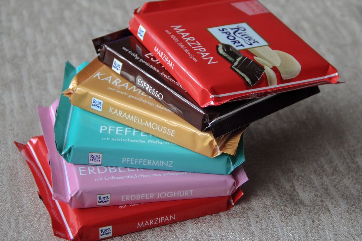 A stack of Ritter Sport, square shaped chocolate bars