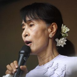 Myanmar pro-democracy leader Aung San Suu Kyi addresses her supporters and the media from the headquarters of her National League for Democracy Monday, April 2, 2012 in Yangon, Myanmar. Suu Kyi claimed victory Monday in Myanmar's historic by-election, saying she hoped it would mark the beginning of a new era for the long-repressed country. (AP Photo)