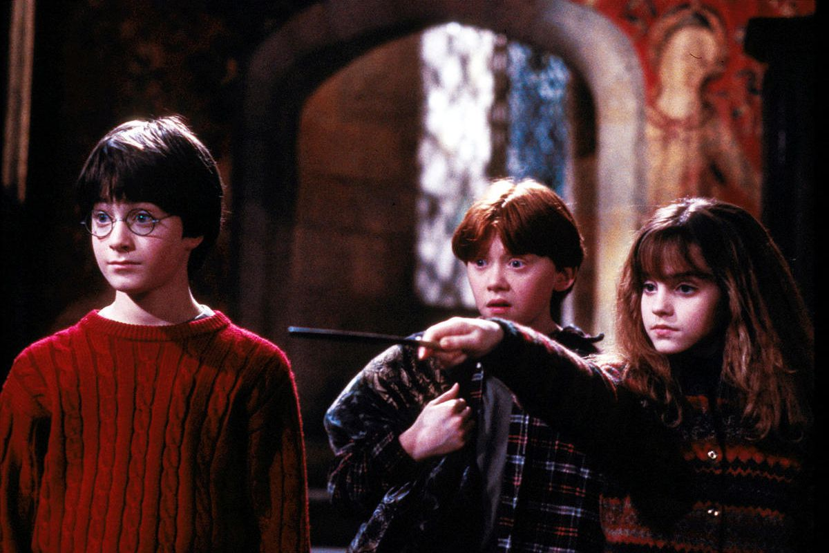 """Left to right, Harry Potter (Daniel Radcliffe), Ron Weasley (Rupert Grint) and Hermione Grainger (Emma Watson) in """"Harry Potter and the Sorcerer's Stone."""" Photo by Peter Mountain"""
