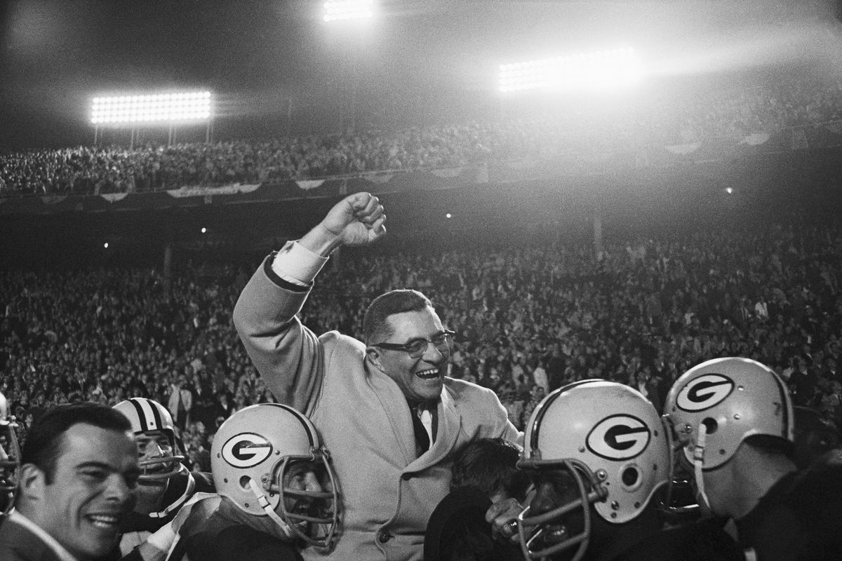 Vince Lombardi Being Carried by Football Players