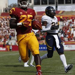 Southern California running back Silas Redd, left, scores a touchdown during the first half of an NCAA college football game against California in Los Angeles, Saturday, Sept. 22, 2012.