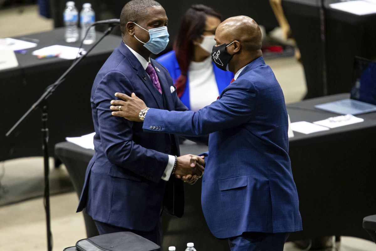 """New Illinois House Speaker Emanuel """"Chris"""" Welch (right) thanks state Rep. Maurice West, D-Rockford, for his nominating speech. West is one of many young Black legislators Welch has mentored on his road to being elected speaker."""