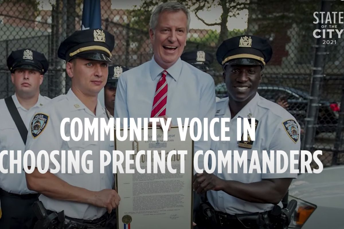 NYPD Deputy Inspector Craig Edelman, left, makes an appearance holding a proclamation in Mayor Bill de Blasio's 2021 State of the City video.