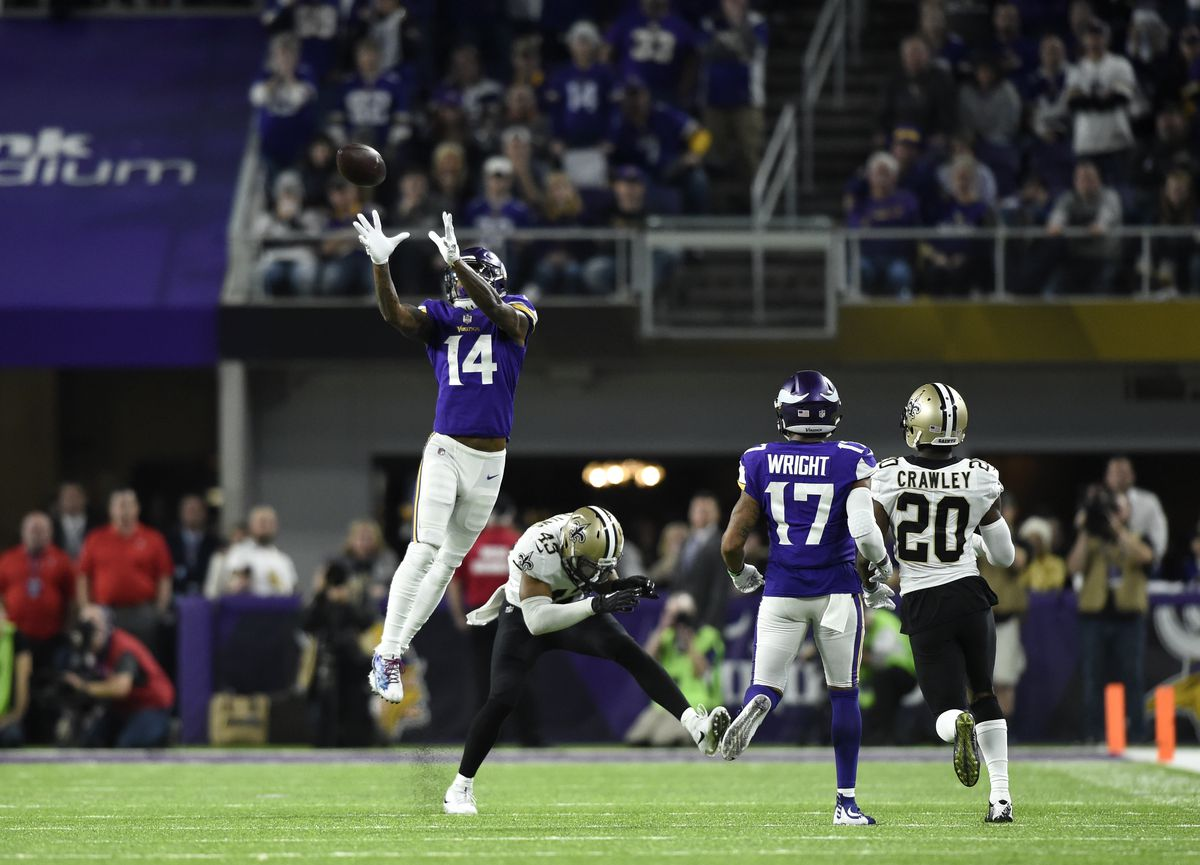 Stefon Diggs #14 of the Minnesota Vikings leaps to catch the ball in the fourth quarter of the NFC Divisional Playoff game against the New Orleans Saints.