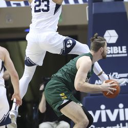 Brigham Young Cougars forward Yoeli Childs (23) defends San Francisco Dons center Jimbo Lull (5) in Provo on Saturday, Feb. 8, 2020.