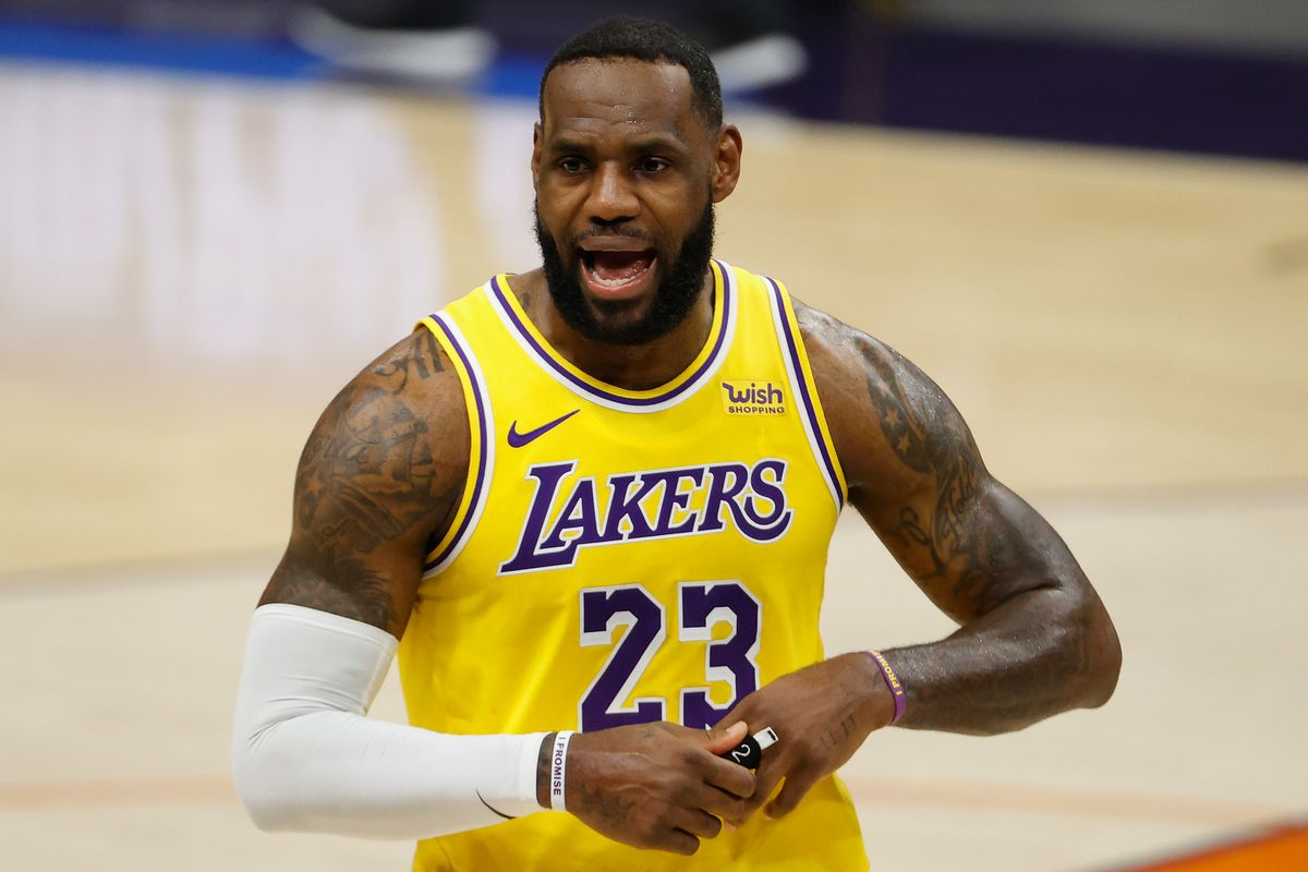 LeBron James of the Los Angeles Lakers reacts during the second half of the NBA preseason game against the Phoenix Suns at Talking Stick Resort Arena on December 18, 2020 in Phoenix, Arizona.